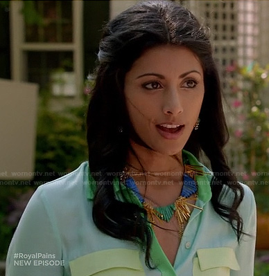 Divya's pastel colorblock shirt and blue spike necklace on Royal Pains