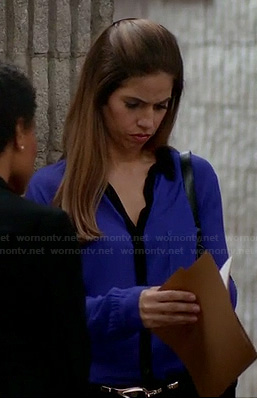 Marisol's blue shirt with black contrast trim and collar on Devious Maids