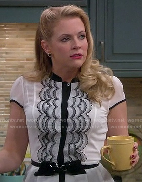 Mel's white and black scalloped lace top with patent bow belt on Melissa and Joey