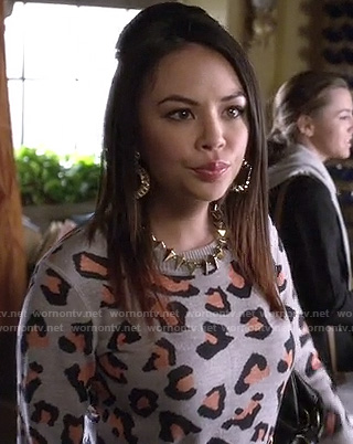 Mona's grey and orange leopard sweater on PLL