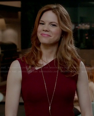 Peri's burgundy red dress with leather detail and asymmetric neckline on Devious Maids