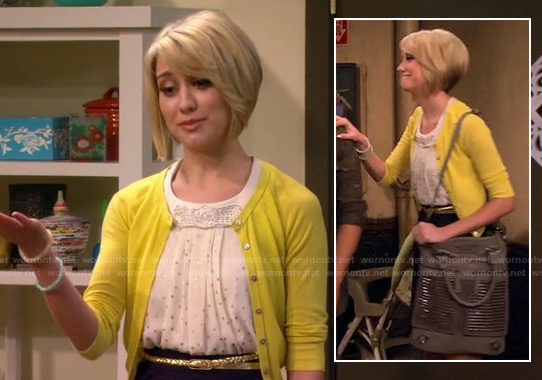 Riley's white and silver polka dot top with bow, yellow cardigan and grey studded shoulder bag on Baby Daddy