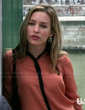 Annie's orange shirt with black trim on Covert Affairs