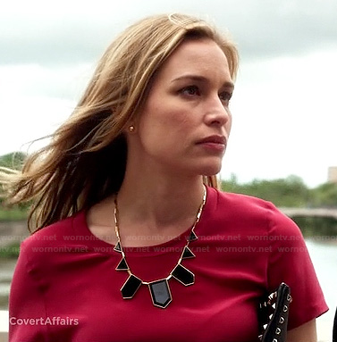 Annie's red top, black geometric necklace and studded clutch on Covert Affairs