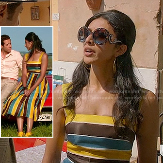 Divya's blue, yellow and black striped dress and round sunglasses on Royal Pains