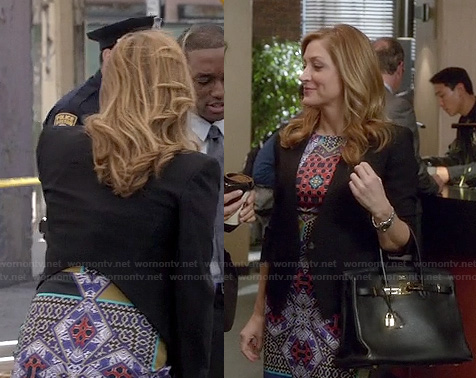 Maura's multi colored dress, black cropped blazer and lock bag on Rizzoli and Isles