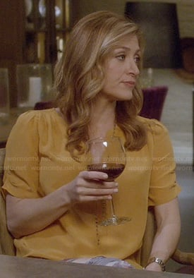 Maura's yellow split neck blouse with ruched sleeves on Rizzoli and Isles