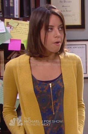 April's brown and blue printed zip front top on Parks & Rec