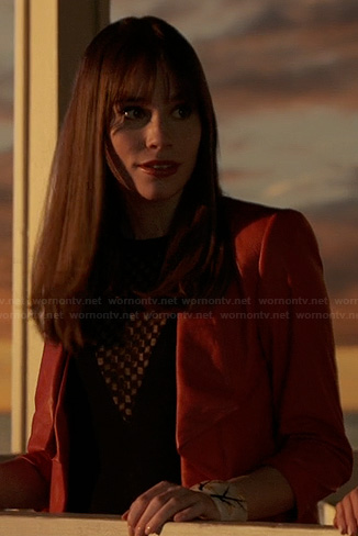 Charlotte's red leather jacket and black chevron detail top on Revenge