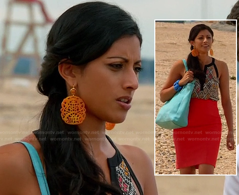 Divya's orange statement earrings, tribal print cutout top and red high waisted skirt on Royal Pains