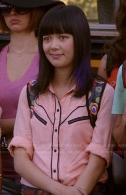 Grace's pink shirt with black trim on Camp