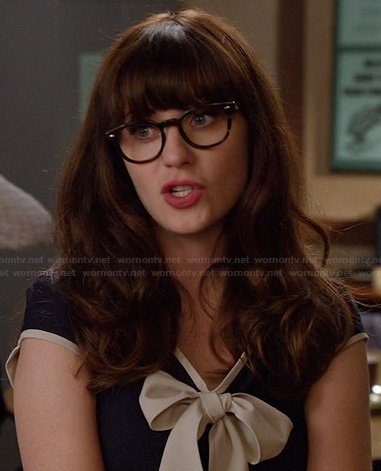 Jessica's navy dress with cream bow front on New Girl