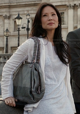 Joan Watson's grey studded bag on Elementary