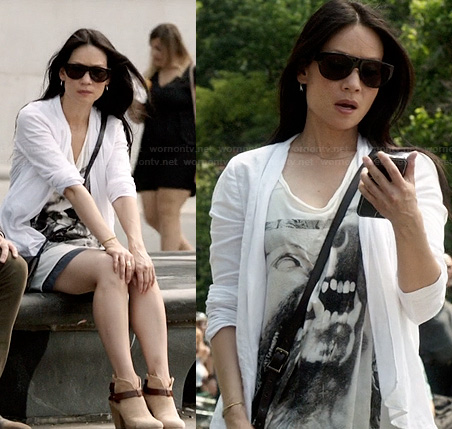 Joan's wolf graphic tee and ankle boots on Elementary
