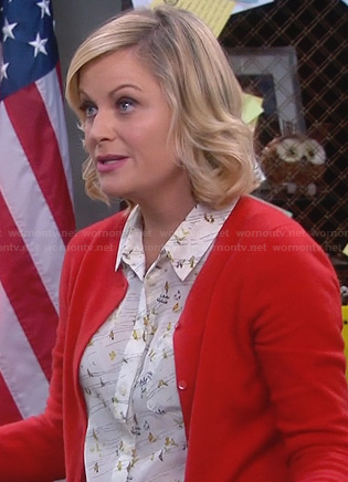 Leslie's white printed shirt and red cardigan on Parks and Recreation