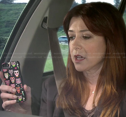 Lily's black owl iPhone cover on How I Met Your Mother