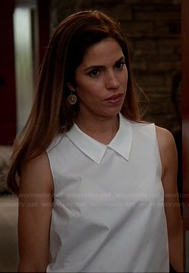 Marisol's white sleeveless top with collar on Devious Maids