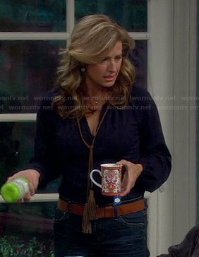 Vanessa's navy blue blouse with tassel tie front on Last Man Standing