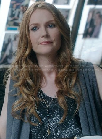 Abby's feather printed top and sleeveless cardigan on Scandal