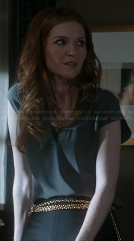Abby's grey split neck blouse on Scandal