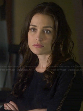 Annie's black top with perforated sleeve panels on Covert Affairs