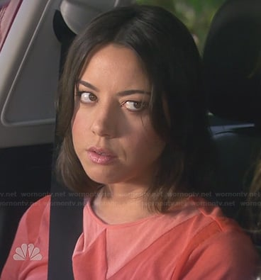 April's red top with fake collar inset on Parks & Rec