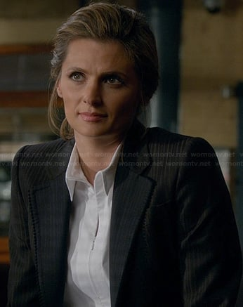 Beckett's white zip front top on Castle