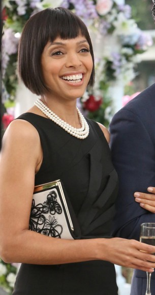 Camille's black folded detail dress and white embroidered clutch at Bones's wedding