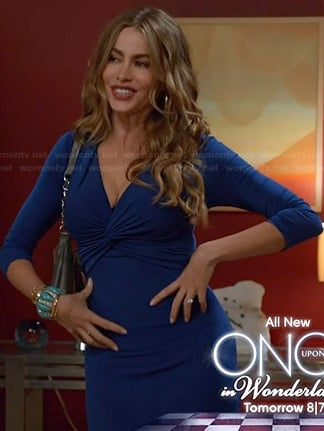 Gloria's blue twist front dress on Modern Family