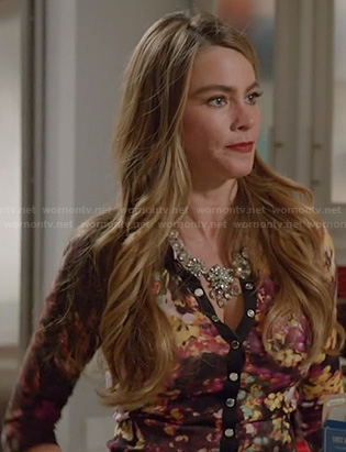 Gloria's black floral print cardigan on Modern Family
