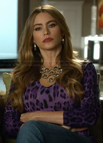 Gloria's purple leopard print top on Modern Family
