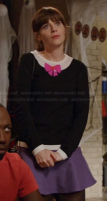 Jess's black sweater with pink bow and purple skirt on New Girl