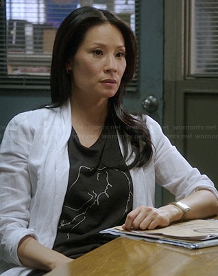 Joan's black line-graphic tee on Elementary