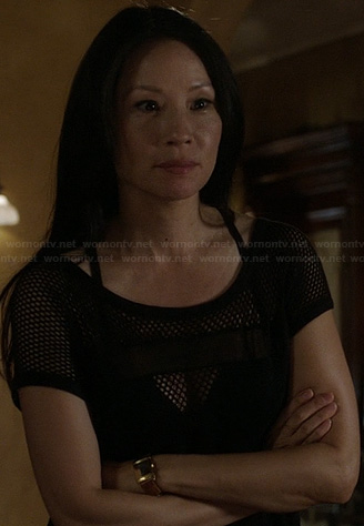 Joan's black netted mesh inset top on Elementary