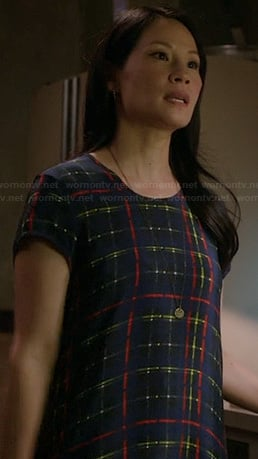 Joan's blue and neon check print dress on Elementary