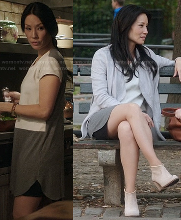 Joan's white leather and grey two-tone dress on Elementary