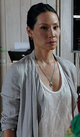 Joan's white snake print tank top on Elementary