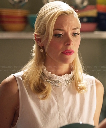 Lemon's white sleeveless top with ruffled embellished neckline on Hart of Dixie