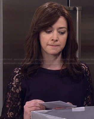Lily's black lace sleeved top on How I Met Your Mother