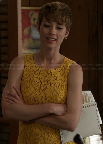 Margaux's yellow lace dress and studded clutch on Revenge