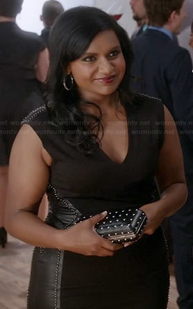Mindy's black dress with studded leather side panels and studded clutch on The Mindy Project
