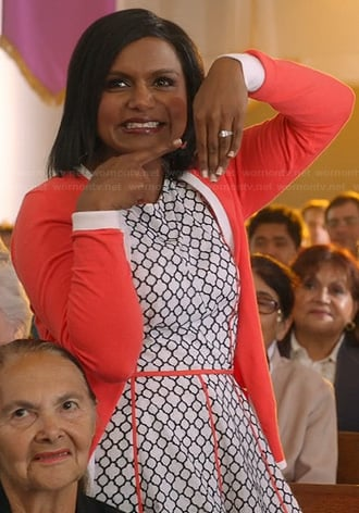 Mindy's black and white printed dress with orange trim and tipped cardigan on The Mindy Project