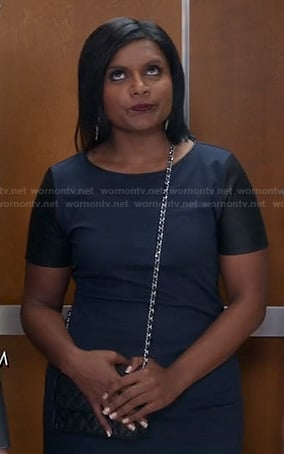 Mindy's navy dress with black leather sleeves on The Mindy Project
