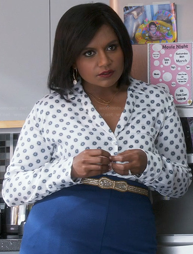 Mindy's white printed shirt, blue high waisted skirt and gold bow belt on The Mindy Project