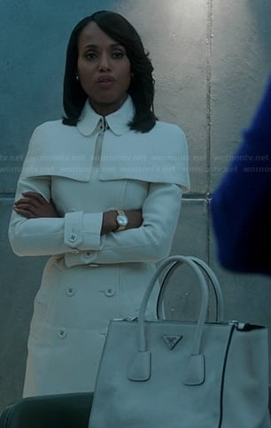 Olivia's white caped trench coat and white purse on Scandal