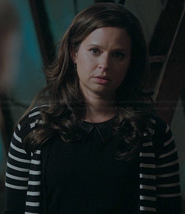 Quinns' black top with leather collar and striped cardigan on Scandal