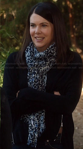 Sarah's black sweater with side zips and navy print scarf on Parenthood