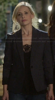 Sydney's black lace cami and dark pinstripe blazer on The Crazy Ones