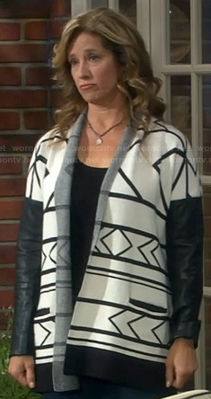 Vanessa's black and white cardigan with leather sleeves on Last Man Standing