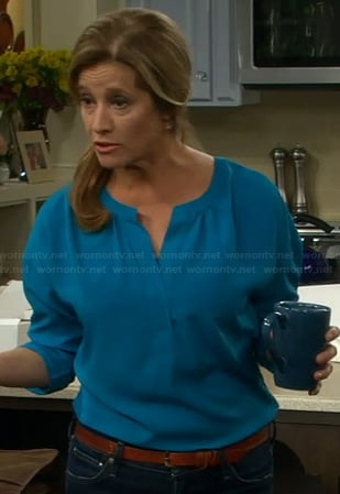 Vanessa's turquoise blue split neck blouse on Last Man Standing